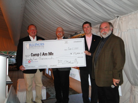 "IFSA President Jim Kreher, Past President Jim Saletta, and Executive Director Phil Zaleski accept a check for Camp ""I Am Me."""